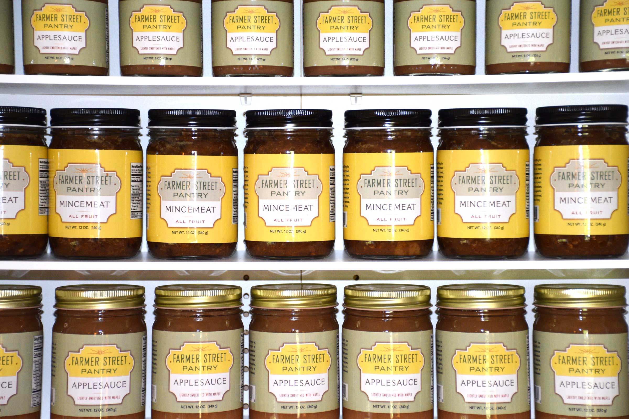 Farmer Street Pantry jars of mincemeat and applesauce on shelves in store