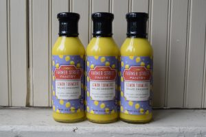 Bottles of lemon turmeric salad dressing